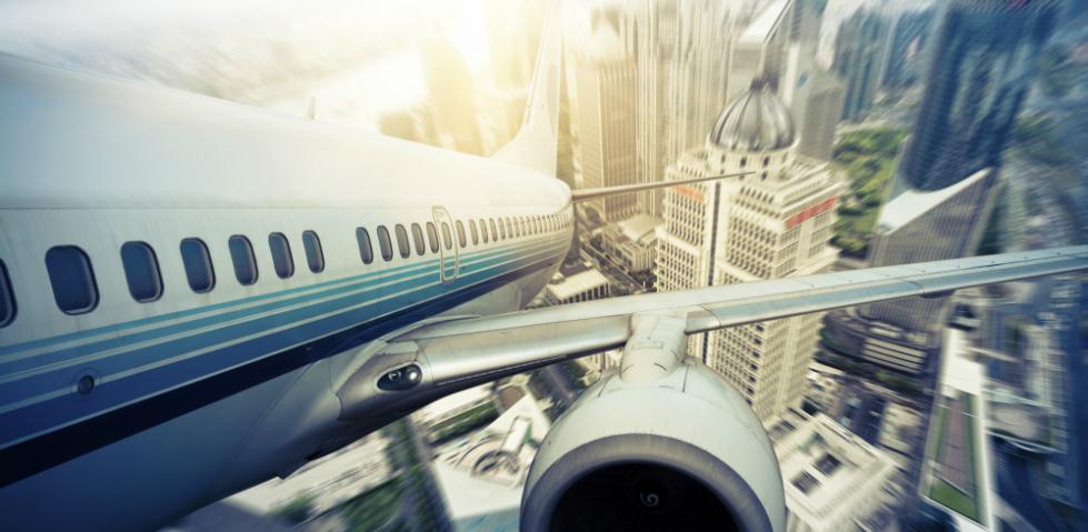 Photo of airplane above the city - Credits: shansekala (ThinkStock)
